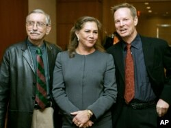 "FILE - Playwright Edward Albee, left, appears with actress Kathleen Turner and actor Bill Irwin moments before a news conference, in Boston, Jan. 4, 2005, held to answer questions about their upcoming production of Albee's play ""Who's Afraid of Virginia Woolf?"""