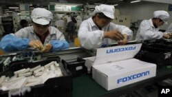FILE - An assembly line in a Foxconn plant.