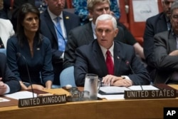 FILE - U.S. Vice President Mike Pence speaks during a high level Security Council meeting on United Nations peacekeeping operations, at U.N. headquarters, in New York, Sept. 20, 2017, as U.S. Ambassador to the U.N. Nikki Haley looks on.