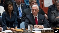 U.S. Vice President Mike Pence speaks during a high-level Security Council meeting on peacekeeping operations, at U.N. headquarters in New York, Sept. 20, 2017, as U.S. Ambassador to the U.N. Nikki Haley looks on.