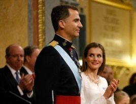 Spain's new King Felipe VI and his wife, Queen Letizia, attend the swearing-in ceremony at the Congress of Deputies in Madrid, June 19, 2014.