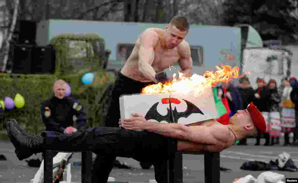 Servicemen of the Belarusian Interior Ministry's special forces unit show off their skills during celebrations of Maslenitsa, or Pancake Week, marking the end of winter at a base in Minsk, Belarus.