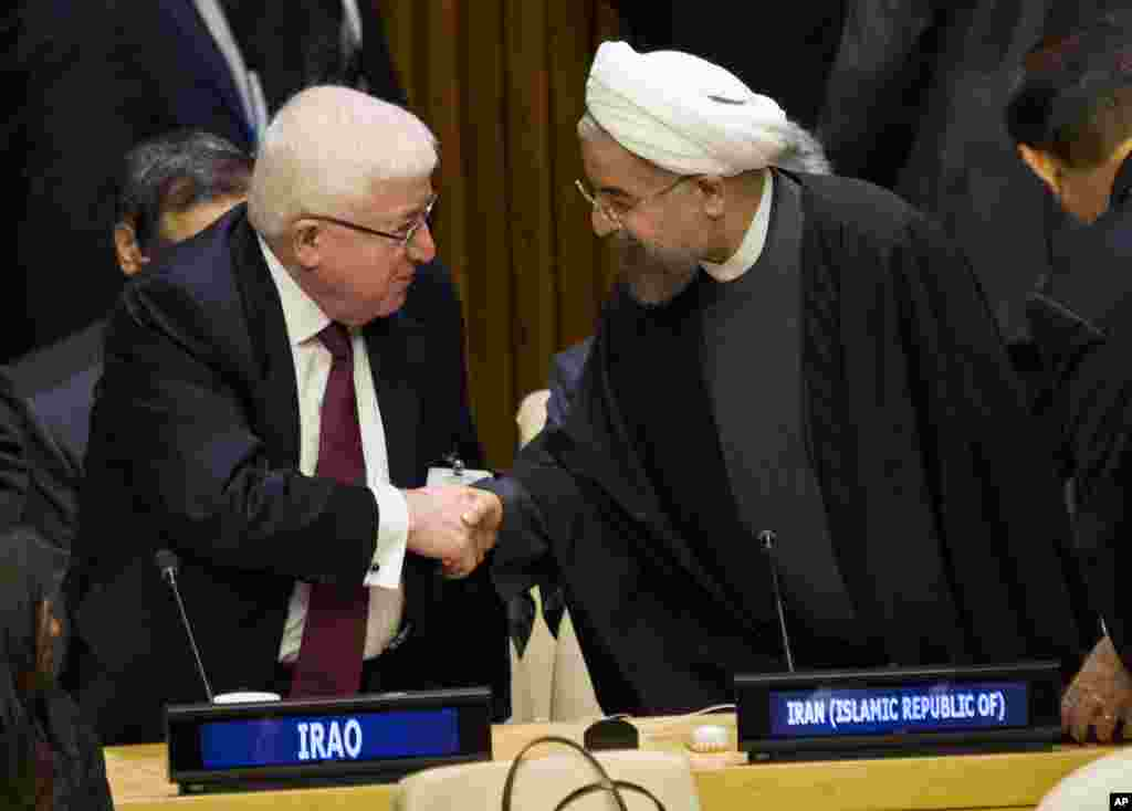 Iraq's President Fuad Masum (left) is greeted by Iranian President Hassan Rouhani as he arrives at the Climate Summit 2014 at U.N. headquarters, Sept. 23, 2014.