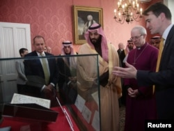 Britain's Archbishop of Canterbury Justin Welby shows The Crown Prince of Saudi Arabia Mohammed bin Salman the Birmingham Koran manuscript - one of the earliest surviving records of the Koran, written in Hijazi, and radiocarbon dated to between 568 and 645 AD - during a private meeting at Lambeth Palace, London, Britain, March 8, 2018.