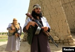 FILE - The Taliban are walking in the Ghanichel district of Nangarhar province, Afghanistan, June 16, 2018.