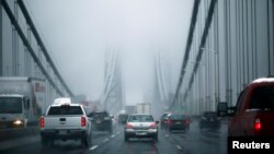 FILE - Cars make their way over the George Washington bridge in New York City in 2014.