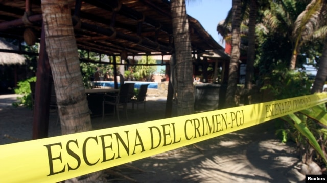 "A yellow police line reading ""Crime Scene"" cordons off a crime scene at a beach hotel, where six female Spanish tourists were raped by armed men, in Acapulco Feb. 6, 2013."