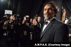 FILE - 'Birdman' director Alejandro Iñárritu appears backstage at the Academy Awards.