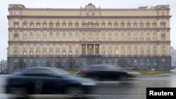 FILE - Cars drive past the headquarters of the Federal Security Service (FSB) in central Moscow, Russia, Nov. 10, 2015.