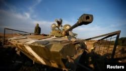 Bộ trưởng Ngoại giao Ukraine Pavlo Klimkin nói việc triệt thoái toàn bộ lực lượng và vũ khí hạng nặng của Nga là điều kiện tiên quyết cho một thỏa thuận ngừng bắn