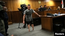Paralympic gold medalist Oscar Pistorius walks across the courtroom without his prosthetic legs during the third day of his resentencing hearing for the 2013 murder of his girlfriend Reeva Steenkamp in the North Gauteng High Court in Pretoria, June 15, 20