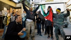 Palestinians dance after hearing that Ariel Sharon, the hard-charging Israeli general and prime minister, died, as they celebrate in the Ein el-Hilweh camp near the southern city of Sidon, Lebanon, Jan. 11, 2014