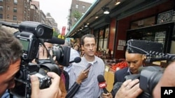 Rep. Anthony Weiner, 46-year-old congressman from New York, is questioned by the media near his home in the Queens borough of New York City, June 11, 2011