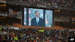 President Barrack Obama speaks to mourners attending the memorial service for former South African president Nelson Mandela at the FNB Stadium in Soweto near Johannesburg, Dec. 10, 2013.
