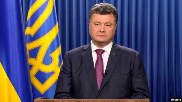 Ukrainian President Petro Poroshenko delivers a speech dedicated to his decree to dissolve parliament in Kyiv, Aug. 25, 2014.