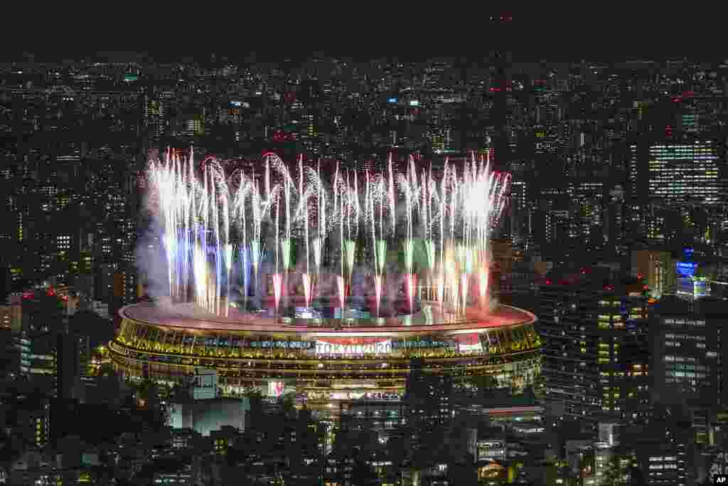 Fireworks illuminate over National Stadium viewed from Shibuya Sky observation deck during the Opening Ceremony for the 2020 Paralympics in Tokyo.