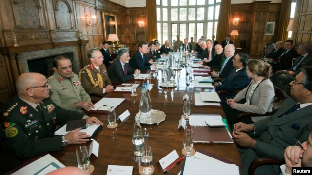 Britains PM Cameron (5th L) chairs a meeting with Pakistan's President Zardari (4th R) and Afghan President Karzai (6th R), at Cameron's country residence, Chequers, in Buckinghamshire, February 4, 2013 file photo.