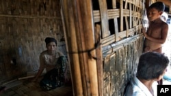 FILE - 17-year old Rorbiza rests at home of Dapaing, North of Sittwe, western Rakhine state, Myanmar after escaping from a human trafficking boat.