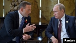 Russia's President Vladimir Putin (R) meets with Australia's Prime Minister Tony Abbott during the Asia Pacific Economic Cooperation (APEC) Summit in Beijing, November 11, 2014.
