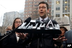 Washington Attorney General Bob Ferguson talks to reporters Feb. 3, 2017, following a hearing in federal court in Seattle. A U.S. judge on Friday temporarily blocked President Donald Trump's ban on people from seven predominantly Muslim countries.