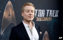 "FILE - Anthony Rapp, cast member in ""Star Trek: Discovery,"" poses at the premiere of the television series in Los Angeles, Sept. 19, 2017."