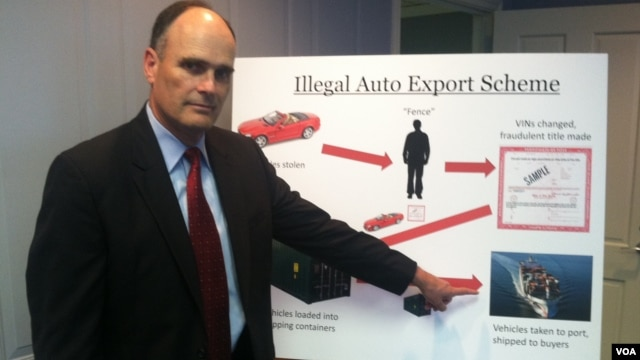 Assistant U.S. Attorney Gilmore Childers outlines the way the international car theft and export ring worked during a press conference in Newark, May 23, 2012. (Adam Phillips/VOA)