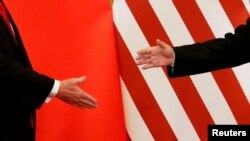 Xi Trump shaking hands Nov 2017