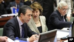 High Representative of the European Union for Foreign Affairs and Security Policy Catherine Ashton (R) speaks with NATO Secretary General Anders Fogh Rasmussen before a Defense Council meeting at the European Union headquarters in Brussels, 9 Dec 2010