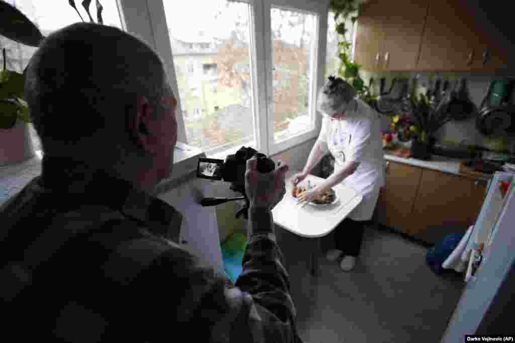 Husband Milan records Jelena Petrovic preparing the food