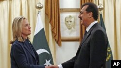 U.S. Secretary of State Hillary Clinton meets with Pakistan's Prime Minister Yusuf Raza Gilani in Islamabad, Pakistan, October 20, 2011.