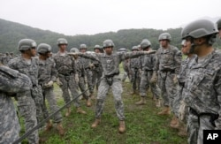 FILE - United States Forces Korea 2nd Infantry Division soldiers take part in an air assault training session at Camp Casey in Dongducheon, South Korea, Friday, July 24, 2015.