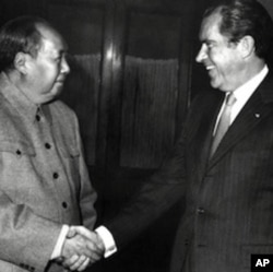 FILE - Chinese leader Mao Zedong shake hands with Richard Nixon after their meeting in Beijing 22 February 1972 during the U.S. President's official visit in China.