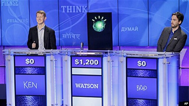 'Jeopardy!' champions Ken Jennings, left, and Brad Rutter, right, look on as an IBM computer called 'Watson' beats them to the buzzer to answer a question during a practice round.