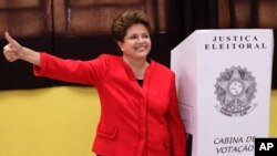 Dilma Rousseff, presidential candidate for the Workers Party, next to a ballot box after voting during Brazil's general elections in Porto Alegre, Brazil, Sunday, Oct. 3, 2010.