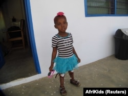 Angela, 5, who was born in northern Ghana without lower legs, is seen with prosthetic limbs at the AfriKids Child Rights Center, Sirigu, northern Ghana, Jan. 2015.