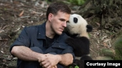 Jake Owens and Qian Qian at the Chengdu Panda Base in China. (Warner Bros./ IMAX Photo)