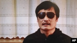 In this image made from video, blind legal activist Chen Guangcheng is seen on a video posted to YouTube, April 27, 2012 by overseas Chinese news site Boxun.com.