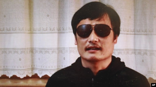 In this image made from video, blind legal activist Chen Guangcheng is seen on a video posted to YouTube Friday, April 27, 2012.