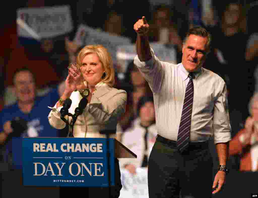 U.S. Republican Presidential candidate Mitt Romney (L) and his wife Ann Romney (R) at a rally late November 5, 2012, at the Verizon Wireless Arena in Manchester, New Hampshire.
