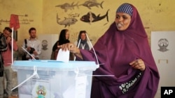 FILE - A woman casts her vote in the presidential election in Hargeisa, in the semiautonomous region of Somaliland, Nov. 13, 2017.