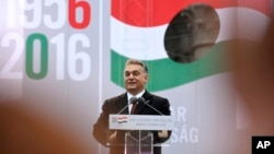 FILE - Hungarian Prime Minister Viktor Orban delivers a speech during the commemoration ceremony of the 1956 Hungarian revolution. Lorinc Meszaros has attributed his success partly to his friendship with Orban.
