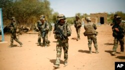 FILE - French soldiers are seen securing an area near Gao, northern Mali, Feb.10, 2013.