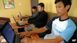 Cambodian men are using internet at a coffee shop in Phnom Penh, file photo.