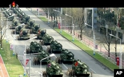 In this image made from video broadcast by North Korean broadcaster KRT, military vehicles prepare for a parade at Kim Il Sung Square in Pyongyang, April 15, 2017. North Korean leader Kim Jong Un has appeared in a massive parade in the capital, Pyongyang, North Korea.