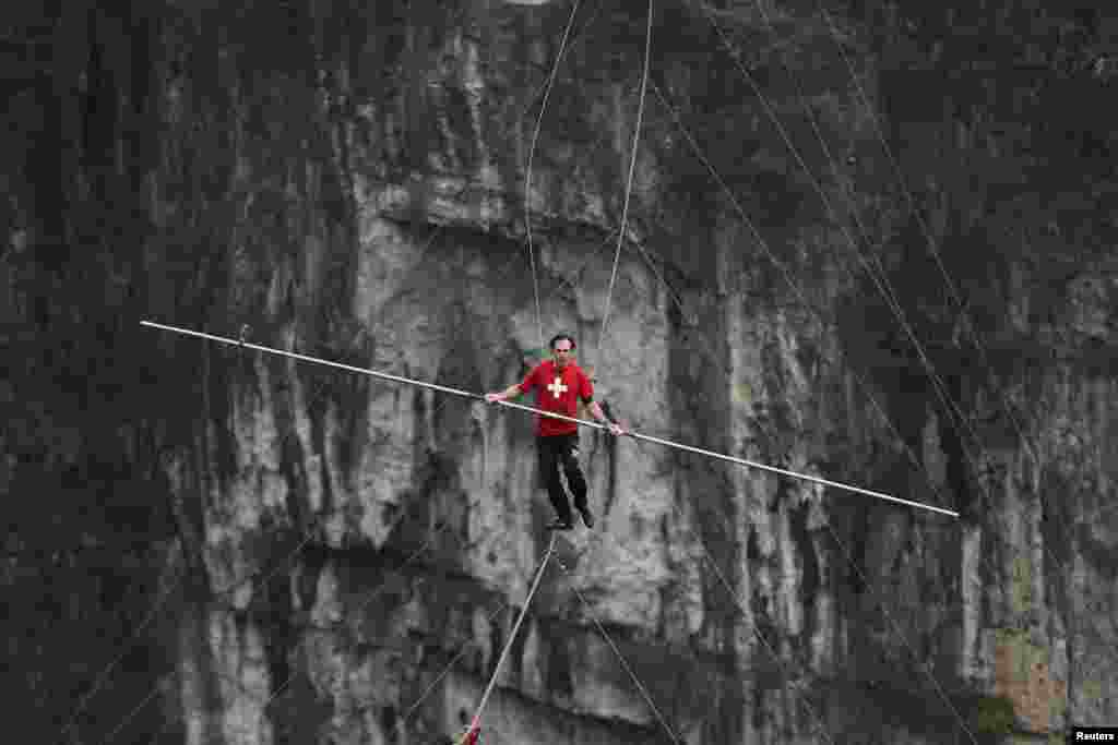 Freddy Nock of Switzerland walks on a tightrope during a competition in Wulong county, Chongqing, China.