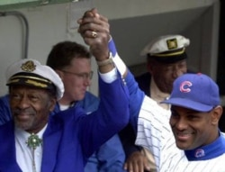 Chuck Berry with Sammy Sosa of the Chicago Cubs before a baseball game in Chicago in 2001