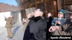 North Korean leader Kim Jong Un watches a long range rocket launch into the air in North Korea, in this photo released by Kyodo, Feb. 7, 2016. (REUTERS/Kyodo)