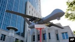 Scale model drone displayed at aviation demonstration, Sacramento, Calif., April 15, 2013.