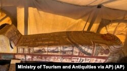 This Sept. 2020 photo provided by the Ministry of Tourism and Antiquities shows one of more than two dozen ancient coffins unearthed near the famed Step Pyramid of Djoser in Saqqara, south of Cairo, Egypt. (Ministry of Tourism and Antiquities via AP)