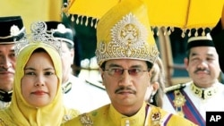 King Tuanku Mizan Zainal Abidin with Queen Nur Zahirah (File)